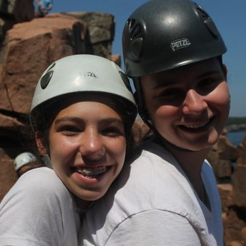 Trust and teamwork is gained through rock climbing.