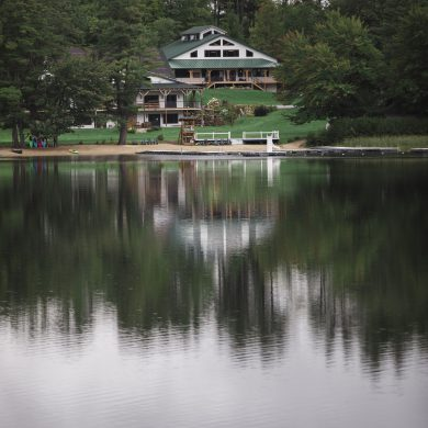 a view of the camp via the lake